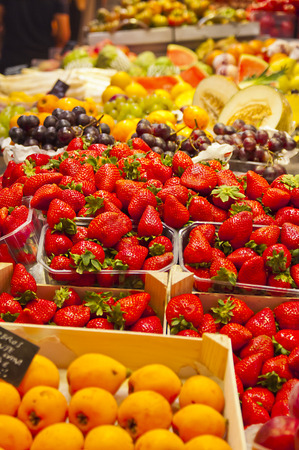 Fruit stall with strawberries in the foreground Stock Photo