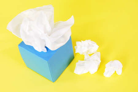 Tissues: Paper tissues in blank blue box on a yellow background.