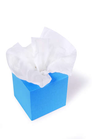 Tissues: Paper tissues in blank blue box isolated on a white background. Stock Photo