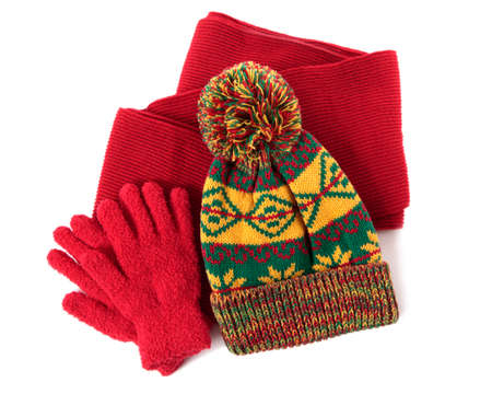 Winter hat, scarf and gloves against a white background.