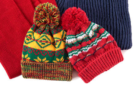 bobble: Two bobble hats and scarves isolated against a white background.