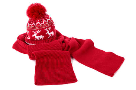 bobble: Red bobble hat and matching scarf isolated against a white background Stock Photo