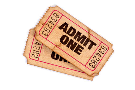 movie theatre: Two old torn movie tickets on a white background.
