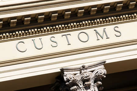 customs: Customs sign on a building Stock Photo