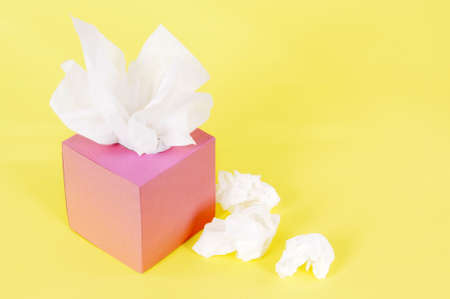 Tissues: Paper tissues in blank pink box on a yellow background.