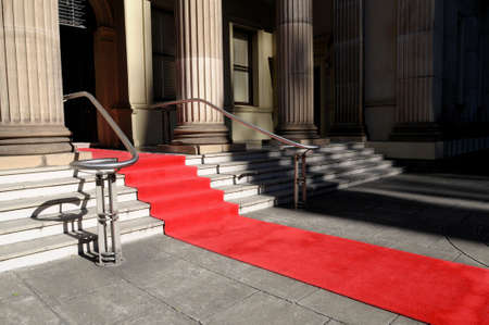 red carpet event: Red carpet laid in front of a luxury hotel building Stock Photo
