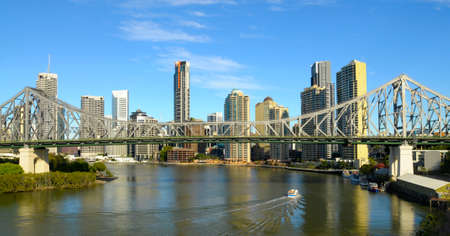 Story Bridge with Brisbane river and City in background.  Space for copy.