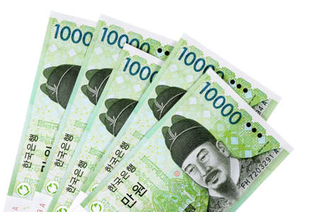 Several Korean 10000 Won currency bills isolated on a white background.