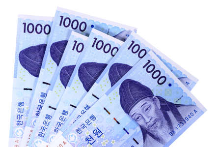 thousand: Several Korean 1000 Won currency bills isolated on a white background.
