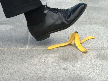banana skin: Businessman about to step on a banana skin or peel