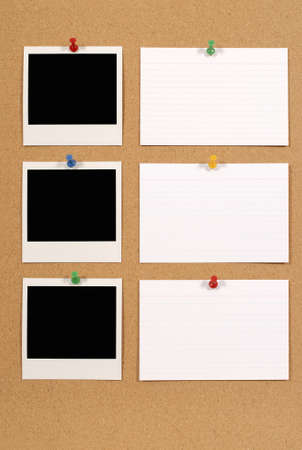 pin board: Cork notice or bulletin board with several blank instant camera photo prints and white office index cards. Space for copy.