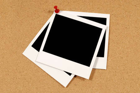 Cork notice or bulletin board with several blank instant camera photo prints. Space for copy. photo
