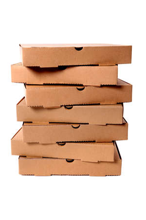 Untidy stack of plain brown pizza boxes isolated against a white background.