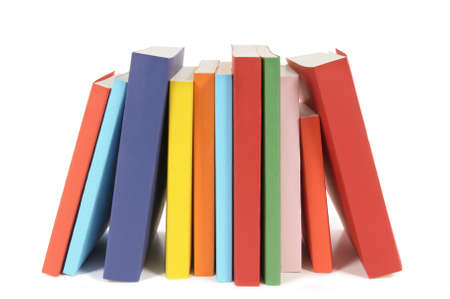 paperback books: Row of colorful paperback books isolated on a white background.  Space for copy. Stock Photo