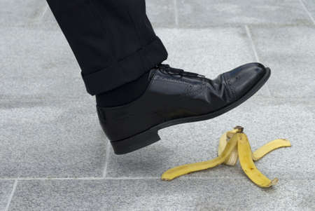 Businessman about to step on a banana skin