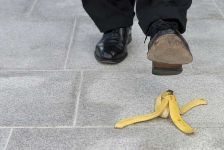 unanticipated: Businessman about to step on a banana skin
