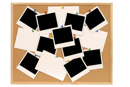 Cork notice or bulletin board with lots of blank instant camera photo prints and white office index cards. Space for copy.