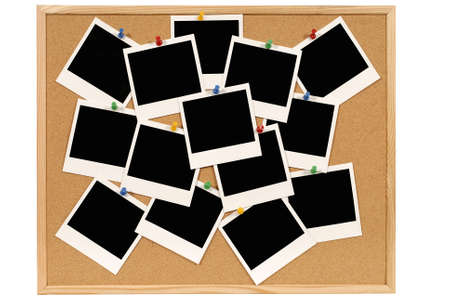 Cork notice or bulletin board with lots of blank instant camera photo prints. Space for copy.