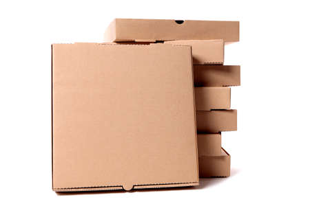 Stack of plain brown pizza boxes with one front facing box for display or advertising.  Space for copy. Stock Photo