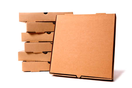 front facing: Stack of plain brown pizza boxes with one front facing box for display or advertising.  Isolated against a white background.  Space for copy.