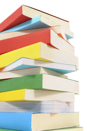 pile of books: Untidy stack or pile of colorful paperback books isolated on a white background.  Space for copy.