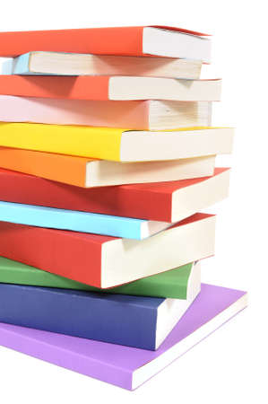 paperback books: Untidy stack or pile of colorful paperback books isolated on a white background.  Space for copy.
