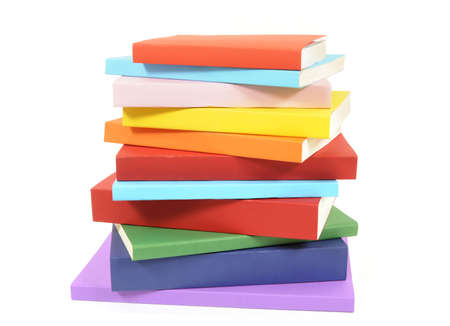Untidy stack or pile of colorful paperback books isolated on a white background.  Space for copy.
