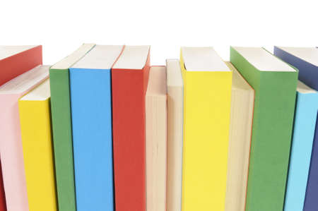 paperback books: Row of colorful paperback books isolated on a white background.