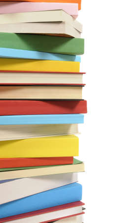 paperback books: Vertical border or stack of colorful paperback books isolated on a white background.  Space for copy.