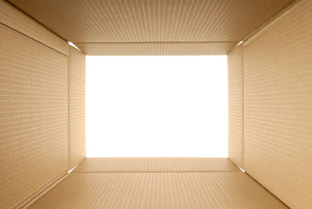 looking through frame: Looking upwards from inside a plain brown cardboard box.  Space for copy. Stock Photo