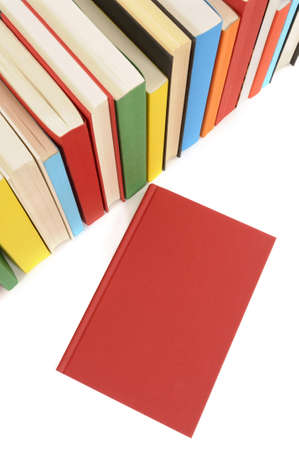 red book: Plain red book with row of colorful books isolated on a white background.  Space for copy. Stock Photo