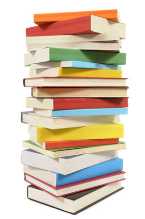 Very tall untidy stack or pile of colorful books isolated on a white background.  Space for copy.