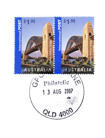 franked: Australian overseas postage stamps cancelled by hand at Brisbane post office. Stock Photo
