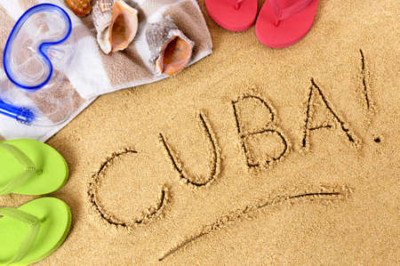 Cuba beach background with towel and flip flops.