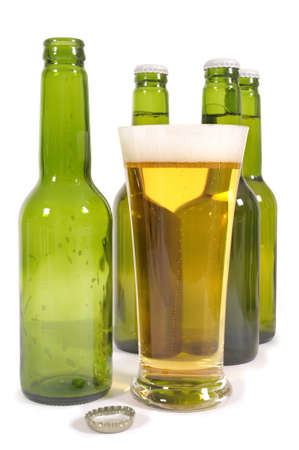 pilsener: Glass of lager beer with green bottles