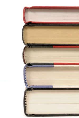 hardback: Stack of hardback books isolated on a white background.