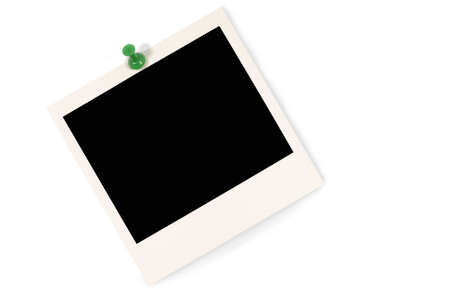 Blank instant camera photo print with green pushpin isolated on a white background.  Space for copy.