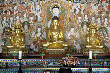 disciples: Golden Buddha and disciples in a Buddhist Temple