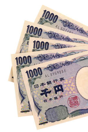 Japanese 1000 Yen currency bills isolated on a white background. photo