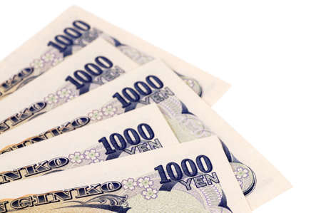Several Japanese 1000 Yen currency bills isolated on a white background. photo