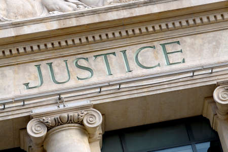 trial: Justice sign on a Law Courts building