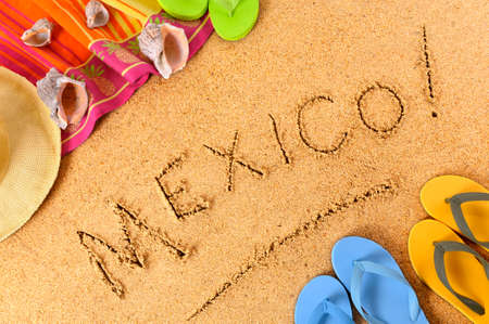 Mexico beach background with towel and flip flops. photo