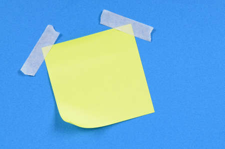 taped: Yellow sticky note taped to blue paper.