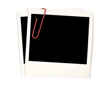 paperclip: Two polaroid instant photo prints with red paperclip Stock Photo
