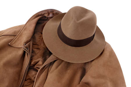 provided: Classic combination of tan felt Fedora and calfskin leather jacket isolated on white (path provided).