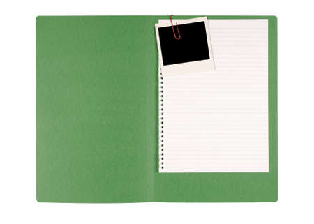 paperclip: Office file folder with untidy note paper and blank instant photo print. Stock Photo