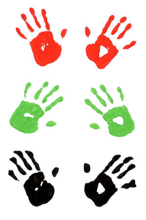 handprints: Child handprints made from vivid acrylic paint on white paper