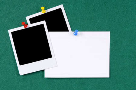 index card: Blank photo prints with office index card pinned to a green felt notice board.  Space for copy.