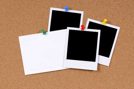 Blank photo prints with office index card pinned to a cork bulletin board. photo