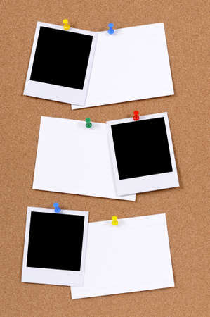 Blank photo prints with office index cards pinned to a cork bulletin board. photo